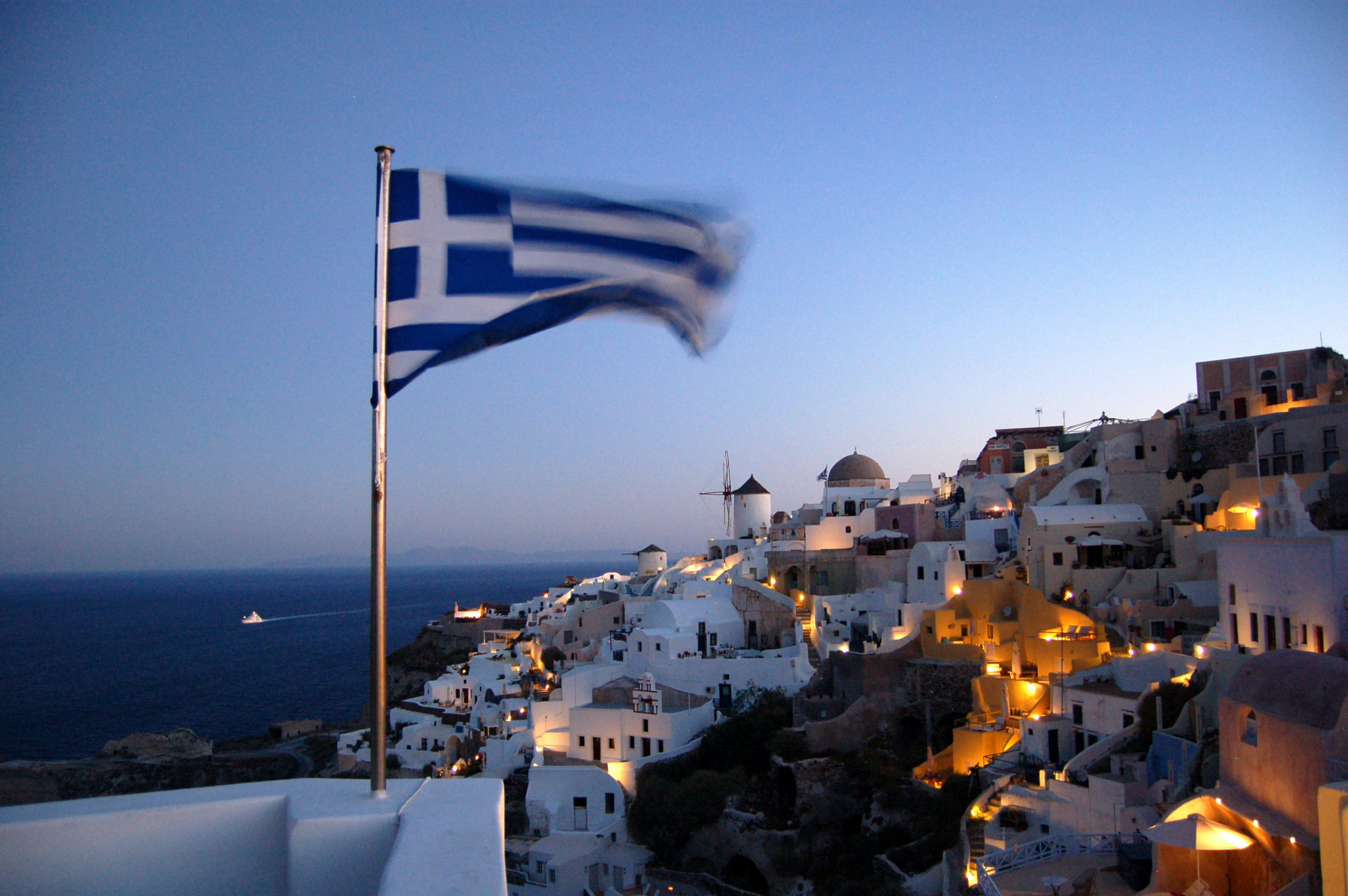 Night skyline in Greece with flag
